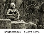Woman Wearing a Gas Mask in the Forest