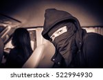 Small photo of Portrait man in black mask and woman in the car,Dangerous man ,Fear ,Murder, hijack, and crime concept,Sepia