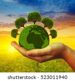 hand holding green planet with... | Shutterstock . vector #523011940