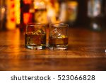 whiskey drinks on  wood in bar | Shutterstock . vector #523066828