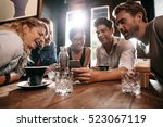 young friends looking at smart...   Shutterstock . vector #523067119