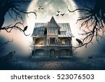 haunted house with full moon in ... | Shutterstock . vector #523076503