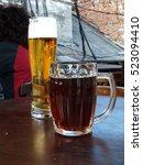 glass of light and dark beer on ... | Shutterstock . vector #523094410