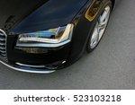 part black car on asphalt... | Shutterstock . vector #523103218