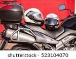 Small photo of helmets Nolan and Suzuki motorcycle, Prague, September 24, 2016, Illustrative Editorial