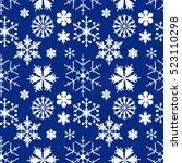set of white snowflakes on blue ... | Shutterstock .eps vector #523110298