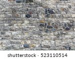 the wall of an old castle. the... | Shutterstock . vector #523110514