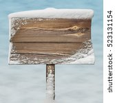 Wooden Signpost With Snow On I...