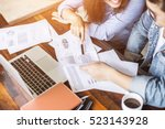 two young business working on... | Shutterstock . vector #523143928
