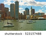 Small photo of Sailboats in front of the skyline of Financial District in Boston, the United States. The city was founded in 1630 by Puritan settlers who came from England. The city is one of the oldest in the US.