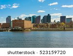 Small photo of One of the riversides with tall buildings in the center of Boston in the United States. The city is one of the oldest in USA. It was founded in 1630 by Puritan settlers from England.
