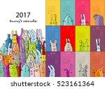 funny rabbits. design calendar... | Shutterstock .eps vector #523161364
