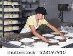 Cheesemaker Preparing Fresh...