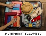 woman packing a luggage for a... | Shutterstock . vector #523204660