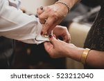 close up crop hands of old aged ... | Shutterstock . vector #523212040