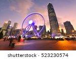ferris wheel in hong kong city... | Shutterstock . vector #523230574