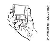 hand holding full glass of... | Shutterstock .eps vector #523234804