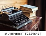 typewriter and books on the... | Shutterstock . vector #523246414