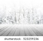 wood table top on winter trees... | Shutterstock . vector #523259236
