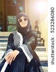 Small photo of young beautiful muslim woman wearing hijab and abaya, Arabic Fashion concept