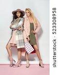 fashionable two women in coat... | Shutterstock . vector #523308958