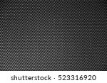perforated metal sheet on dark... | Shutterstock . vector #523316920