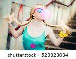 pretty blond girl chewing gum... | Shutterstock . vector #523323034