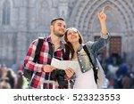 portrait couple of travellers... | Shutterstock . vector #523323553