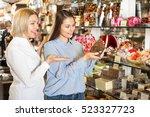 female friends selecting bars... | Shutterstock . vector #523327723