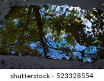 after rain reflection on puddle.... | Shutterstock . vector #523328554