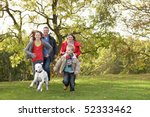 Stock photo young family outdoors walking through park with dog 52333462