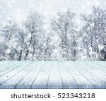 wood table top on winter trees... | Shutterstock . vector #523343218