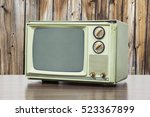 green vintage television with... | Shutterstock . vector #523367899