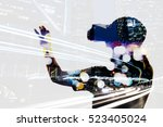 Stock photo double exposure of woman using the virtual reality headset 523405024