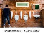 Man Standing Pee Brick Wall...