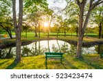 green wood bench in summer park ... | Shutterstock . vector #523423474