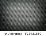 dark carbon fiber background   Shutterstock . vector #523431850