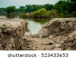 the curb erosion from storms.... | Shutterstock . vector #523433653