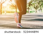 young lady running on road