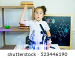 young girl making science... | Shutterstock . vector #523446190