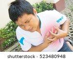 man having a heart attack.pain | Shutterstock . vector #523480948