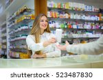 pharmacist and client in a... | Shutterstock . vector #523487830