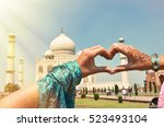 heart shaped hands against taj... | Shutterstock . vector #523493104