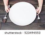 little girl holding fork and... | Shutterstock . vector #523494553