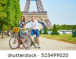 romantic couple riding bicycles ... | Shutterstock . vector #523499020