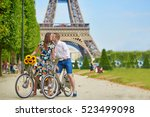 romantic couple riding bicycles ... | Shutterstock . vector #523499098
