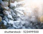 fir branch on snow with festive ...   Shutterstock . vector #523499500