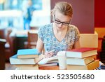 beautiful young student with... | Shutterstock . vector #523505680