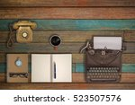 vintage typewriter and coffee... | Shutterstock . vector #523507576