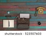 vintage typewriter and coffee... | Shutterstock . vector #523507603